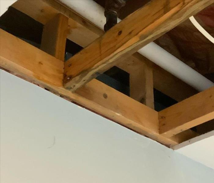 image of a ceiling of a commercial building with the water damaged drywall fully mitigated and removed