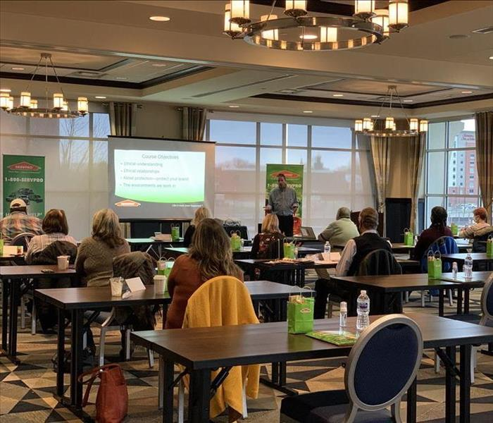image of a room full of local Erie insurance agents taking a continuing education course offered by SERVPRO