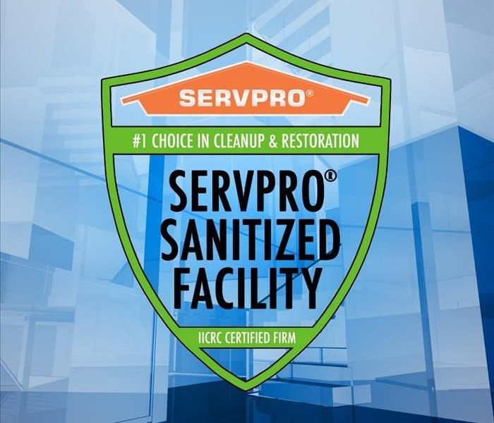 blue stock image of empty office building with SERVPRO shield image in the middle