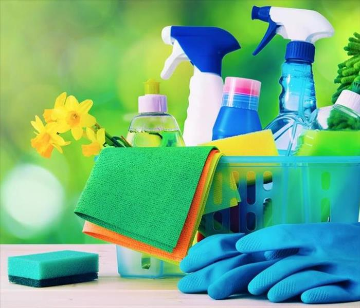 image of cleaning products in basket like: sponges, spray bottles, wipes, gloves, and more